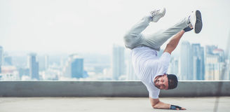 Street artist breakdancing outdoors. Bboy doing some stunts - Street artist breakdancing outdoors Stock Photography