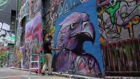 Street artist creating graffiti stock footage