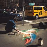 Street artist drawing with chalk Stock Photos