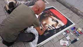 Street artist drawing classic portraits in public royalty free stock photos
