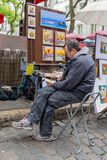 Street artist drawing a picture at Montmartre, Paris, France Stock Images