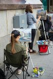 Street artist draws a picture stock photography