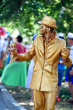 15: Street artist dressed as a gold statue takes up an position,in honor of a holiday of navy of Russia Royalty Free Stock Photography