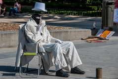 Street artist dressed in white royalty free stock photography