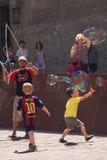 Street artist entertain children with bubbles with bubbles. Street artist entertain children on square a front of Basilica del Santa Maria del Mar, Barcelona Stock Images
