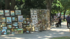 Street artist and an exhibition of his works in the center of Varna, Bulgaria stock video footage