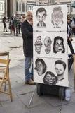 Street artist expects walking around tourists. Florence, Italy-April 01, 2014:Street artist expects walking around tourists stock image
