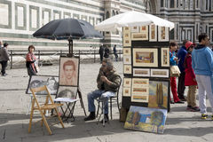 Street artist expects walking around tourists. Florence, Italy-April 01, 2014:Street artist expects walking around tourists royalty free stock photography