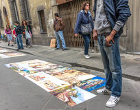 Street artist in Florence, Italy. Street artist salling art work outside the Accademia di Belle Arti museum in Florence, Italy Stock Photography