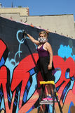 Street artist in gas mask painting mural at Wellington Court in Astoria section in Queens. NEW YORK - JUNE 12, 2016:  Street artist in gas mask painting mural at Stock Images