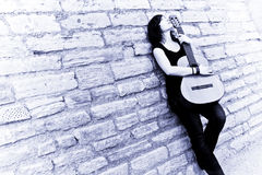 Free Street Artist Holding Guitar Royalty Free Stock Photography - 4932577