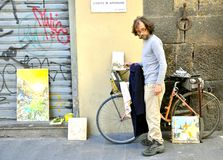 Street artist in Italy. Painter selling art on the streets of Florence, Italy Stock Photos