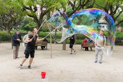 Street artist makes big soap bubbles Stock Photos