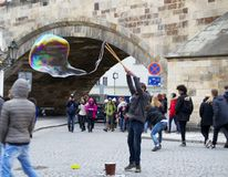 Street Artist making bubbles Stock Image