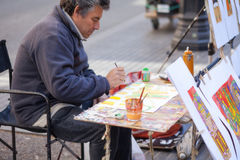Street artist Painter in Baceelona Royalty Free Stock Images