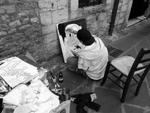Street artist. Painting on a canvass during Anagni medieval city annual fair, Italy. Photograph taken on April, 2013 stock images