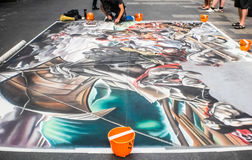 Street artist painting on the floor Royalty Free Stock Photos