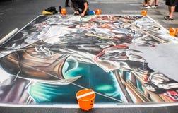 Street artist painting on the floor Royalty Free Stock Photos