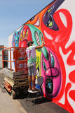 Street artist painting mural at new street art attraction Coney Art Walls Stock Images