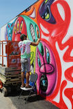 Street artist painting mural at new street art attraction Coney Art Walls Stock Photography