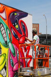 Street artist painting mural at new street art attraction Coney Art Walls Royalty Free Stock Photography