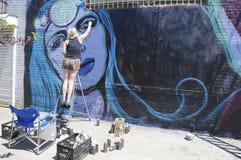 Street artist painting mural at Williamsburg in Brooklyn Stock Image