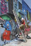 Street artist painting mural at Williamsburg in Brooklyn Stock Image