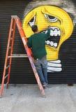 Street artist painting mural at Williamsburg in Brooklyn Royalty Free Stock Photo
