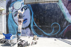 Street artist painting mural at Williamsburg in Brooklyn Stock Images