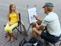 Street artist painting portrait of young girl, Moscow, Russia Royalty Free Stock Images