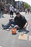 Street artist painting the road at the Toronto Royalty Free Stock Image