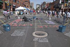 Street artist painting the road at the Toronto Royalty Free Stock Photos