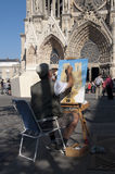Street artist paints a picture of a Reims. REIMS - OCTOBER 01: Street artist paints a picture of a Reims Notre Dame Cathedral on October 01, 2011 in Reims Royalty Free Stock Photos