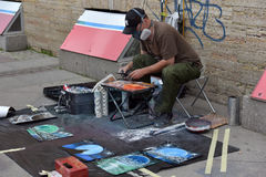 Street artist paints a picture of a sprayer Royalty Free Stock Photos