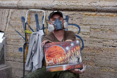 Street artist paints a picture of a sprayer Stock Image