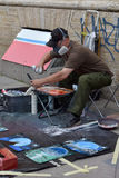 Street artist paints a picture of a sprayer Stock Photo