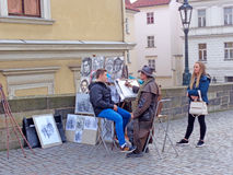 Street artist paints a portrait Stock Images