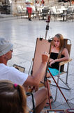 Street artist paints the portrait of a young girl. Zadar, Croati Royalty Free Stock Photo