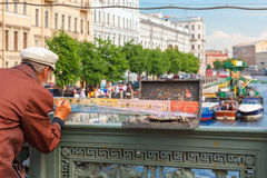 Street artist paints river landscape in St Stock Photography
