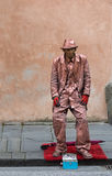 Street artist performer, downcast eyes in Pisa, Italy. Stock Photo