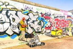 Street artist performing guitar at East Side Gallery in Berlin Stock Images