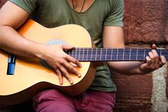 Street artist playing on a guitar.  Royalty Free Stock Photo