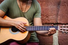 Street artist playing on a guitar.  Royalty Free Stock Photography