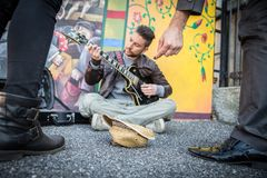 Street artist playing guitar on the streets Stock Photography
