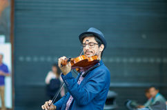 Street artist playing Violin in hystoric center of Florence Stock Image
