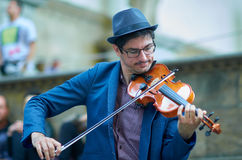 Street artist playing Violin in hystoric center of Florence stock photos