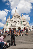 Street artist on Sacre Coeur stairs, Paris Royalty Free Stock Photography