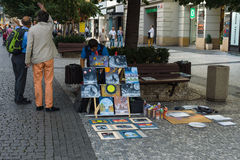 Street artist selling his paintings Royalty Free Stock Photos