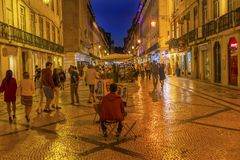 Artist Rua Augusta Evening Walking Shopping Street Baixa Lisbon. Street Artist Shoppers Rua Augusta Street Evening Walking Shopping Street Black White Tiles Royalty Free Stock Photo