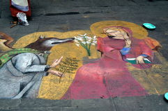 Street artist in Siena. Siena, Italy - July 27, 2015: Street artist drawing on the floor stock photography